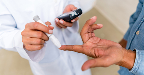 Doctor checking patient's blood sugar levels