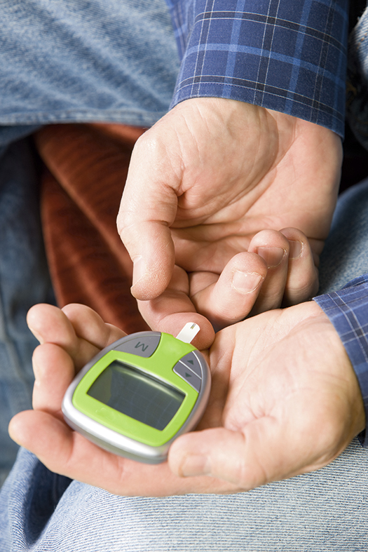 A man tests his blood sugar levels